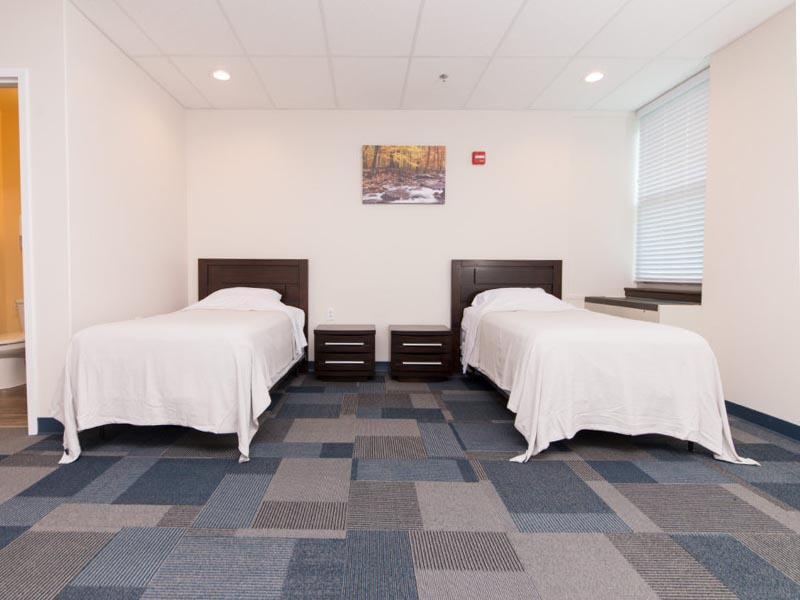 Two beds in a room at Bradford Recovery